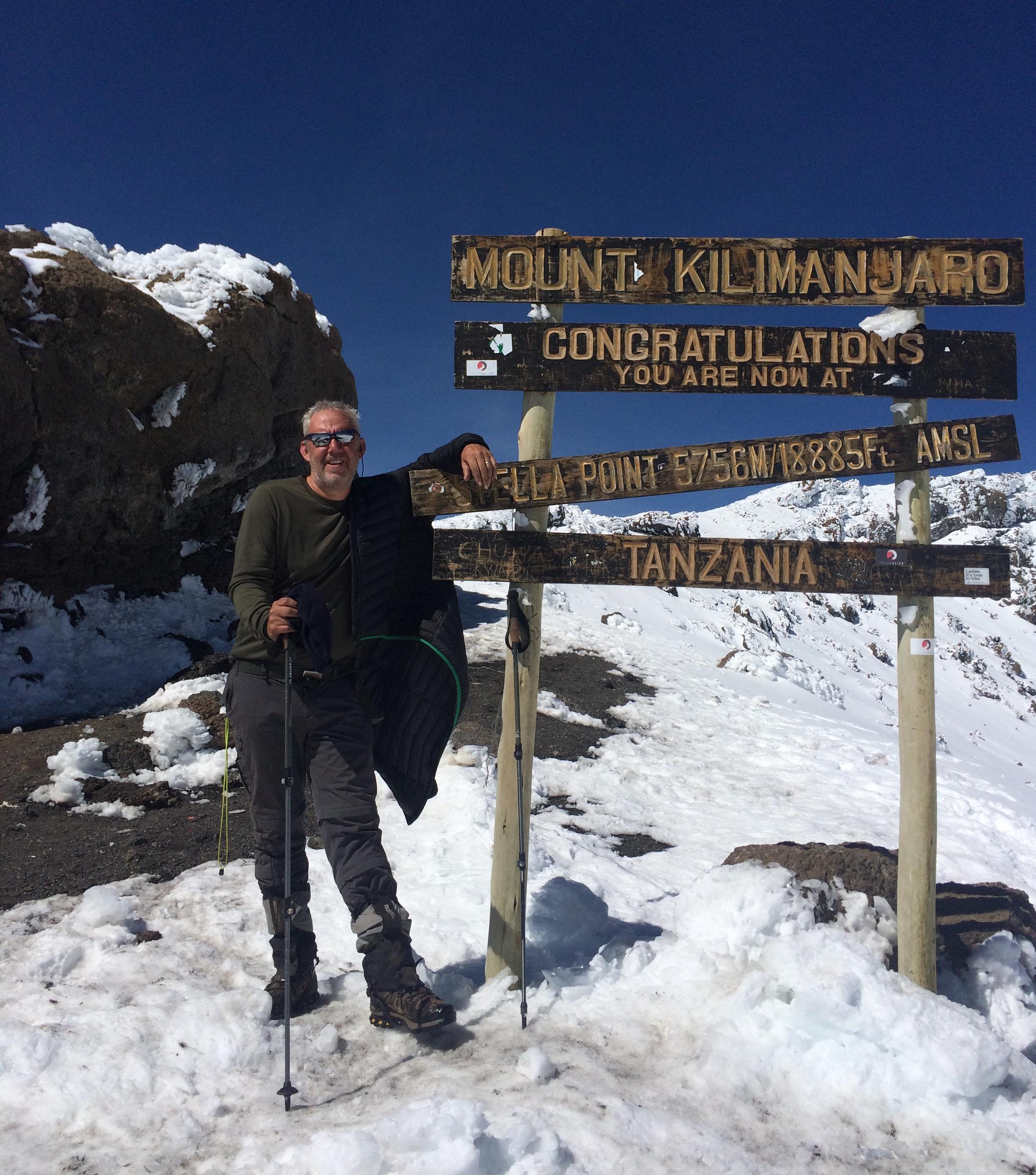 Mark Elward at the summit of Mount Kilimanjaro